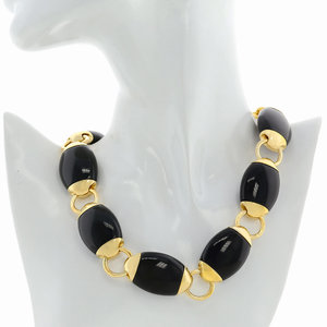 BEATLE - BEATLE is a wonderful choker made of light gold that emphasizes your cleavage. The black resins elements seem like funny beatles that chase on the chain! - A.Z. Bigiotterie